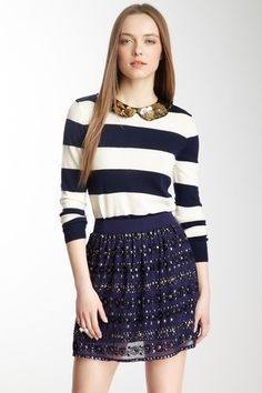 This outfit is perfect for someone with an inverted triangle shape and an autumn skin tone. The shirt has horizontal lines that look restful and casual on this model. The skirt would look best on a smaller girl because of the dull texture and the clinging soft texture. The color blue on this shirt demands respect and responsibility on the girl.