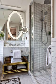 Polished stone amenities and large showers make for luxurious and elegant bathrooms inside the new Hilton Hotel, Paris.