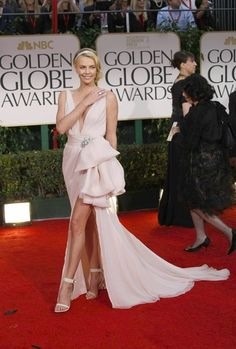 Charlize Theron in a chiffon Dior couture gown and a Cartier headband @ the Golden Globes 2012
