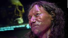 Some of the first modern settlers of Britain from 10,000 years ago had dark skin and curly hair, according to new analysis of a historic skeleton.