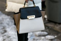 Jessica Hart toted a colorblock Zac Posen bag. Street Style Accessories at New York Fashion Week #NYFW