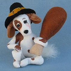 Annalee Doll Description: Open eyes, white with brown spot boddy, black Pilgrim hat, holds turkey drumstick. Companion is 350213. Adorable!