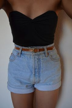 Simple. High waisted shorts and strapless black crop top. Love it.