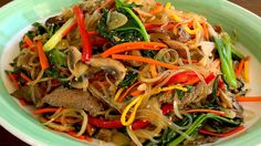 Japchae (Glass noodles stir-fried with vegetables: 잡채) English caption: ...