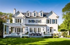An expanse of French doors and windows stretches almost end-to-end allowing plenty of access to the large outdoor terrace and inviting inside the sounds and breezes of nearby Lake Michigan.- Elegant Homes ® / Photo: Werner Straube Modern Farmhouse Exterior, Colonial Exterior, Elegant Homes, Home Photo, Traditional House, My Dream Home, French Doors, Exterior Design, Patio Design
