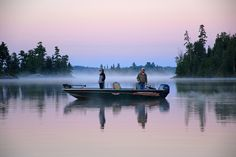 "Second place photo in the NOSFC's ""Best Fishing Photo"" Contest. Congratulations to Al Scherwinski!  Taken on Stevens Bay, Lake of the Woods in Nestor Falls, ON.  An early morning fishing on the bay."