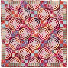 """""""Pickle Dish Quilt"""" : Kaffe Fassett's Quilt Romance.  The design is inspired by a vintage Double Wedding Ring quilt."""