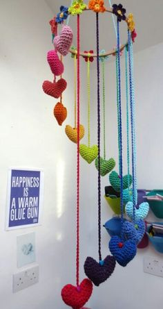 Knitted heart mobile... Maybe attach bells, for a windchime effect!!!.......... Multi colour,rainbow,
