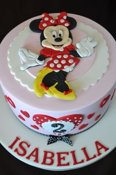 Children's Cakes - A cute birthday cake with the ever popular Minnie Mouse. The image is made completely from icing, allowed to dry and set as a keepsake. I had so much fun making this cake and really happy with how it looks.