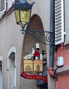 """Shop sign """" La cour des Saveurs""""."""