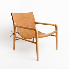 The Smith - Leather sling chair in Raw Tan. Available at www.barnabylane.com.au