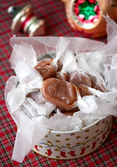 Vanilla Bean Caramels | Tide and Thyme 1 cup heavy cream 5 tablespoons unsalted butter, cut into pieces 1/2 tsp vanilla 1 vanilla bean pod, split and scraped 1 1/2 cups sugar 1/4 cup light corn syrup 1/4 cup water