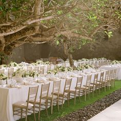 Love the white and family style seating. Also like that there aren't chair backs, brings the reception area more in tune with the outside venue.