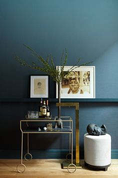 The chic bar set-up features a cart by Modern Living Supplies and a vintage brass floor lamp by Chapman. The bronze bust is an Oliver Gustav creation.