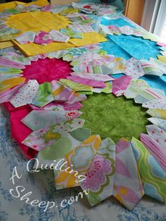 For the center of the flowers, I traced around a dinner plate and cut out a circle of fabric that would completely cover the open center of the flowers. I always use water soluble glue to hold my fabric together for projects like this.