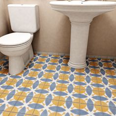 Warm tones of burnt orange is tempered by royal blue to form a geometric pattern with sloping lines set against a white base glaze. This collection is a durable choice for your indoor floor or wall installation.