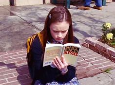 """Gilmore Girls, season episode """"P.,"""" aired 3 May Lorelai Leigh """"Rory"""" Gilmore is played by Alexis Bledel. She's reading the novel Ulysses by James Joyce. Margaret Mitchell, Mick Mars, Stars Hollow, James Joyce, Harper Lee, William Faulkner, Samuel Beckett, Tennessee Williams, Dan Brown"""