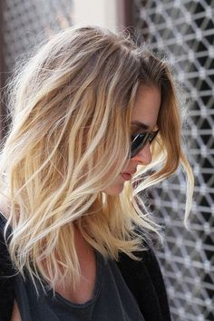 beachy waves - Long hair with layers and long, blended bangs is a super-flattering style that works on everyone. Read more: http://www.dailymakeover.com/trends/hair/fall-haircuts-2014/#ixzz3E0h15rP8