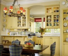 Love the pale yellow of these cabinets.