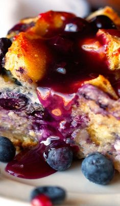 Overnight Blueberry French Toast Casserole Recipe ~ studded with fresh blueberries, which is super easy to prepare and topped with warm homemade Blueberry Syrup.