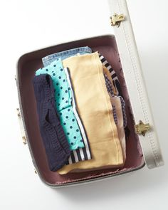 Never stand apprehensively over an empty suitcase again -- here are a few simple ways you can pack efficiently for your next trip.