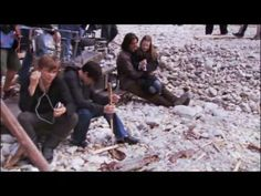 William (with his iphone), Skandar (with a stick?), Georgie sitting on Ben's lap.