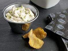 French Onion Dip  Ingredients  2 tablespoons unsalted butter  2 Vidalia onions, sliced into 1/4-inch-thick rings  2 large shallots, sliced into 1/8-inch-thick rings  3 cloves garlic, minced  2 cups sour cream  1 cup mayonnaise  1 teaspoon celery salt  1 teaspoon Worcestershire sauce  Kosher salt and freshly ground pepper  Chives, finely chopped, for garnish  Potato chips, for serving