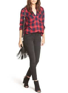Pairing a plaid shirt with black skinny jeans and booties for an easy on-the-go ensemble.
