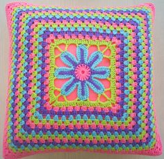 the flower in a granny square crochet cushion cover / pillow