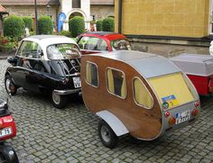 BMW Isetta with wood-sided camper trailer