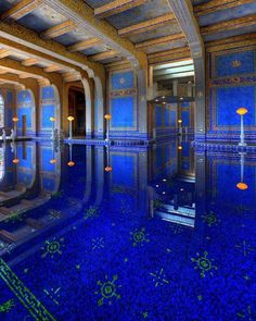 The reflection at The Roman Pool at Hearst Castle is an architectural wonder. The rich blue mixed with gold creates a truly magical space. || @architectanddesign by Julia Morgan. (1934)  #California #USA #architectanddesign