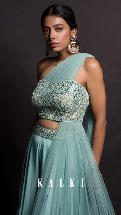 Mint Green Flared Palazzo And Blouse Set In Crepe With Mirror Abla Work Online - Kalki Fashion Mint green crepe flared palazzo and blouse set with mirror abla work only on Kalki SEE DETAILS Indian Gowns Dresses, Indian Fashion Dresses, Dress Indian Style, Indian Designer Outfits, Indian Wear, Designer Bridal Lehenga, Bridal Lehenga Choli, Lehnga Dress, Designer Party Wear Dresses