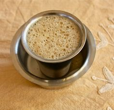 'South Indian Coffee---also known as Madras Filter Coffee or Kaapi is a sweet milky coffee made from dark roasted coffee beans and chicory especially popular in the southern states of Andhra Pradesh, Karnataka, Kerala and Tamil Nadu. Coffee Set, Coffee Love, Indian Coffee, Kerala Food, India Food, Indian Sweets, Coffee Roasting, Coffee Recipes, Indian Food Recipes