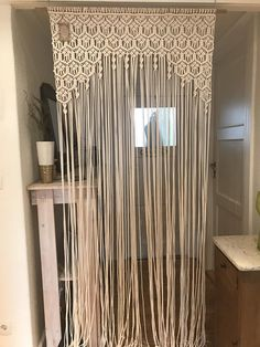 Macrame Curtain, Room Divider, Wall Hanging, Wedding Ceremony, Window Treatment Materials: 3-mm cotton rope, wooden dowel rod (sold without hooks!) Measurements: Width - with rod 100 cm / without rod 85cm, Length - 180 cm, 200 cm or 220 cm Color: beige, cream, off-white This item can
