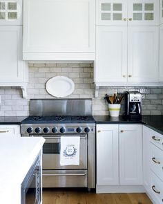 Kitchen - incorporate microwave in island. Vent hood