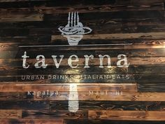 Italian Restaurant in Maui-Taverna's logo on our rustic wood walls is a great spot for photo ops.