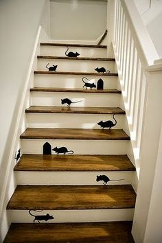 Thinking about doing a staircase remodel for your home? Here is a clever staircase idea. Check out this black mice and mouse holes painting on wooden stairs. Painted Staircases, Painted Stairs, Wooden Stairs, Staircase Painting, Wooden House, Stair Art, Stair Decor, Staircase Decoration, Decorating Staircase