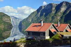 Cabin in Aurland, Norway. A high standard cabin by the shoreline of the Aurlandsfjord, Western Norway. The area lies peacefully by the fjord, with its own parking lot and a quay with the opportunity for boat rental. The cabin has three bedrooms, a veranda facing the fjord,...