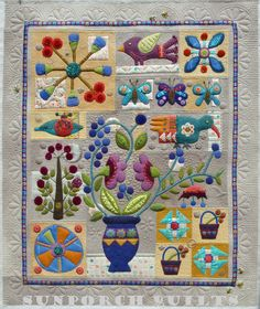 In Full Bloom wool quilt, quilted by Sunporch Quilts. 2014 BOM by Sue Spargo.