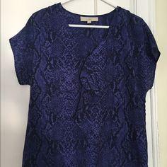 Detail purple and black pattern that looks like snakeskin v neck