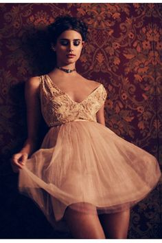 Deja Vu Mini | Party-perfect dress featuring embroidered beading along the bodice and full tulle skirt by Free People. Plunging neckline and back.