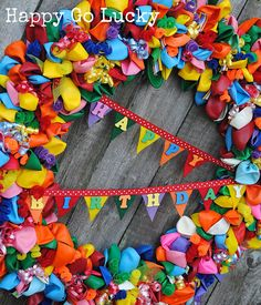 Balloon birthday wreath.. colorful and cheerful.. #wreath #party