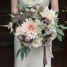 Blush and eggplant florals with eucalyptus, particularly the dahlia.