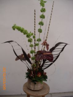 Tropical flower arrangement dark red and orange for wedding and event