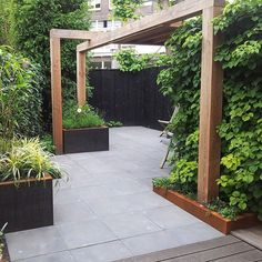 The wooden pergola is a good solution to add beauty to your garden. If you are not ready to spend thousands of dollars for building a cozy pergola then you may devise new strategies of trying out something different so that you can re Small Gardens, Outdoor Gardens, Tropical Gardens, Back Gardens, Garden Structures, Outdoor Structures, Building A Pergola, Wooden Pergola, Pergola Designs
