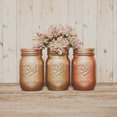 Great metallic mason jars for centerpieces. Bronze Wedding, Gold Wedding Theme, Wedding Flowers, Wedding Colors, Wedding Bells, Rustic Wedding, Mason Jar Vases, Painted Mason Jars, Party Centerpieces