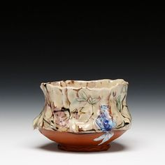 Mel Griffin    Description:      earthenware with multiple slips and glazes