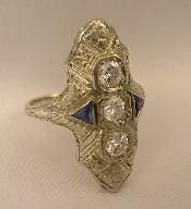 This is a vintage 1920-1930 filigree sapphire and diamond ring