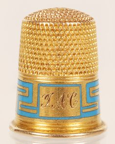 JP: A Faberge gold and champleve enamel thimble, circa 1890.