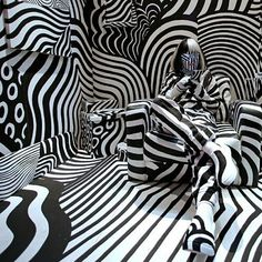 A model poses as part of art installation by artist Shigeki Matsuyama at an exhibition in Tokyo. Matsuyamaís installation features a strong contrast of black and white, which he learned from dazzle camouflage used mainly in World War I. Op Art, Black Mode, Arte Linear, Dazzle Camouflage, Pictures Of The Week, Art Abstrait, Art Graphique, Japanese Artists, Art Furniture